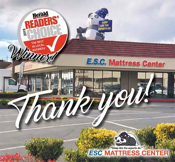 Thank you with E.S.C. Mattress Center in the background