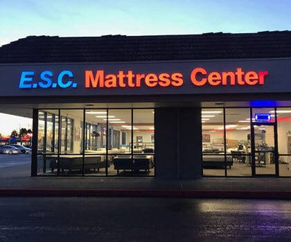 ESC Mattress Center from outside at night