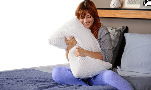 Person hugging pillow