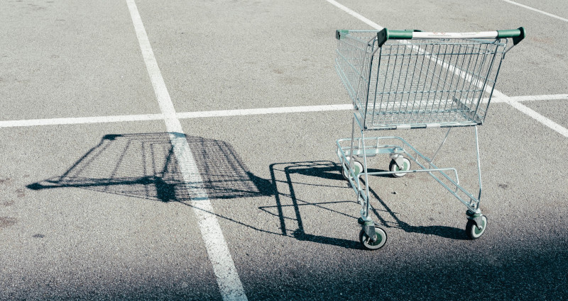 Abandoned shopping cart in the parking lot.