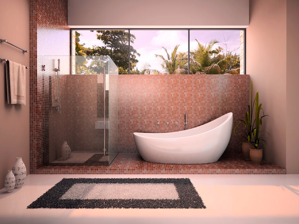 Modern bathroom with frameless shower enclosure.