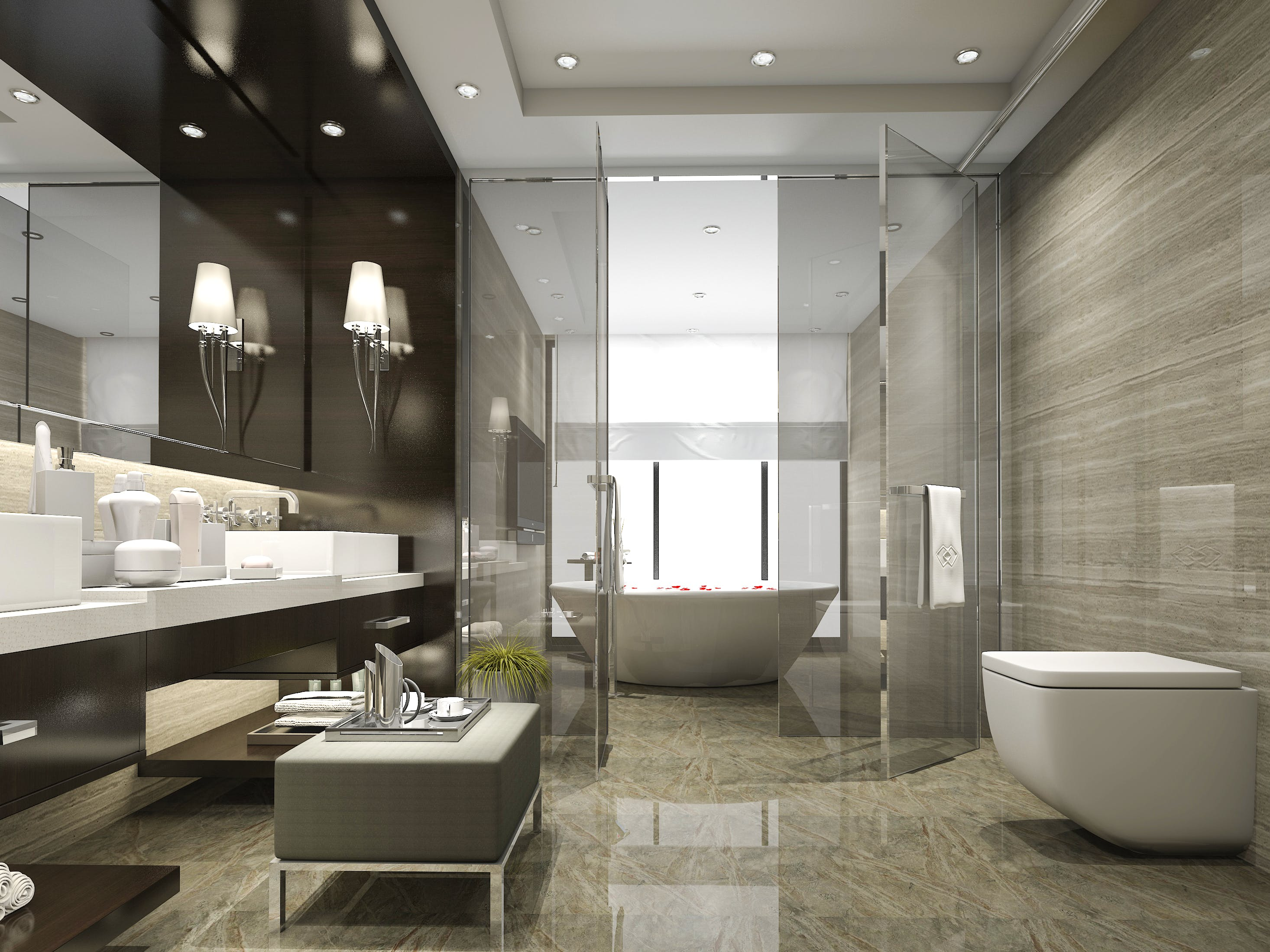 Modern bathroom with new glass shower enclosure.