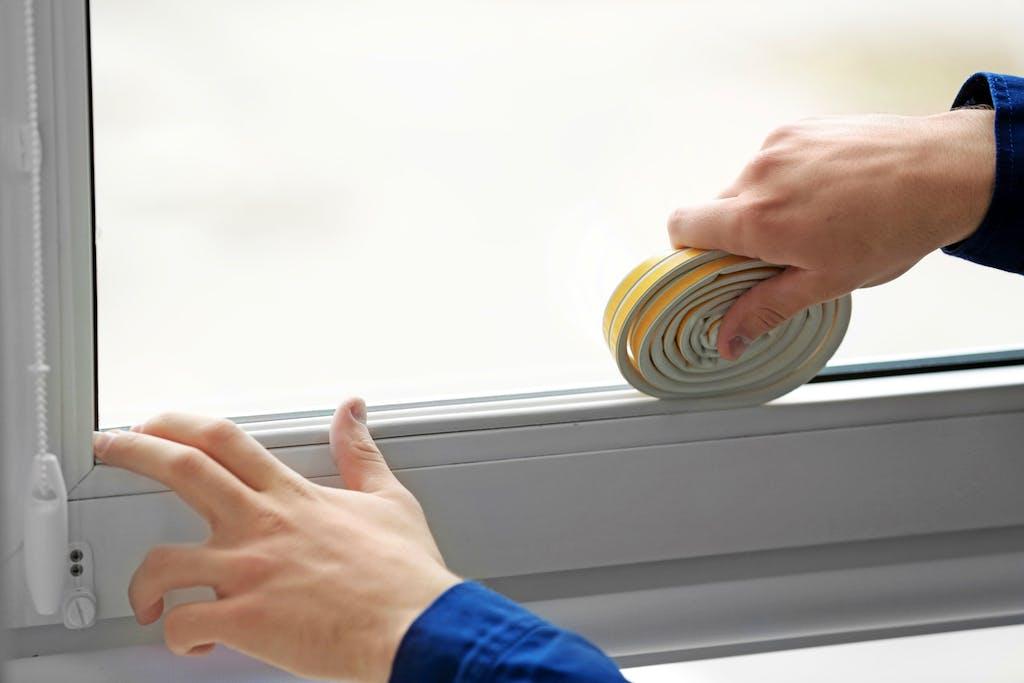 Window repair - weatherstripping drafty window.