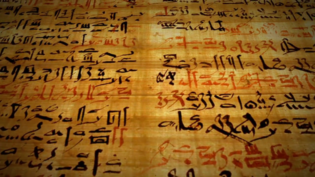 Ancient writing on papyrus scroll