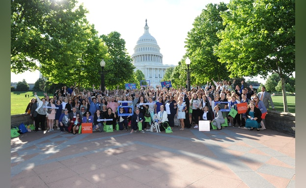 Advocate in front of U.S. Capitol building