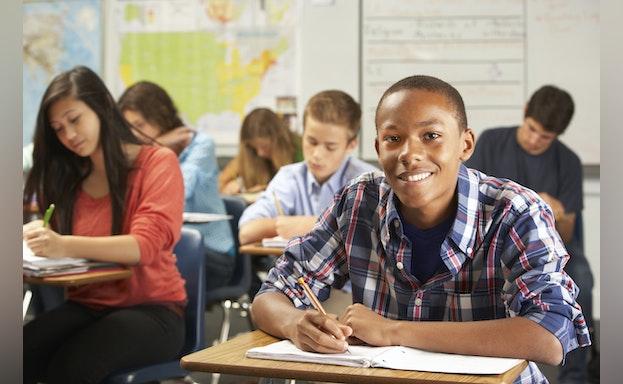 African American boy at desk in school