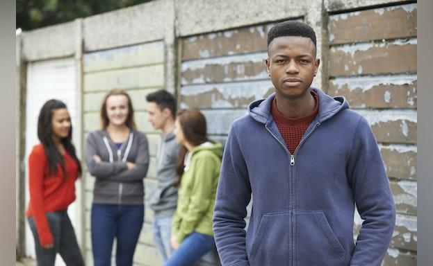 Teen standing alone