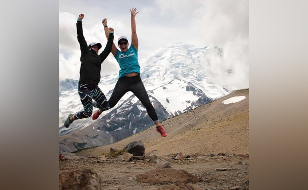Jumping with mountains in the background