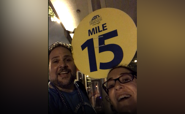 Man and woman in front of mile marker 15