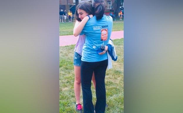 Woman and girl hug