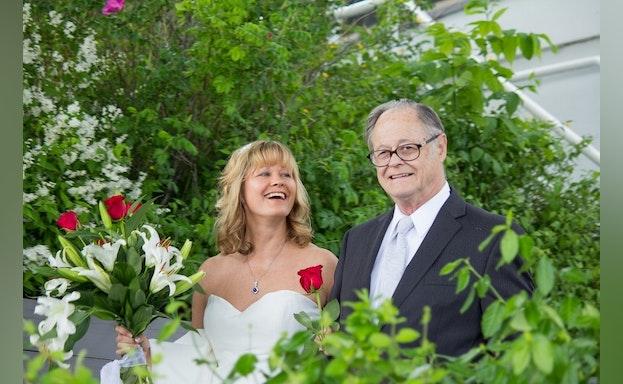 Man and woman among flowers