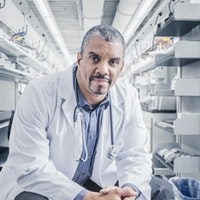 Physician sitting and facing camera