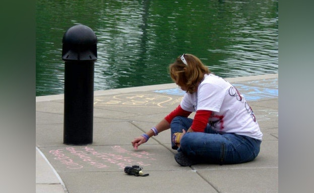 Drawing with chalk on sidewalk