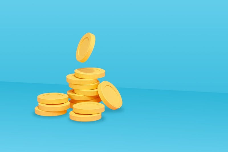 gelbe Münzen mit blauem Hintergrund