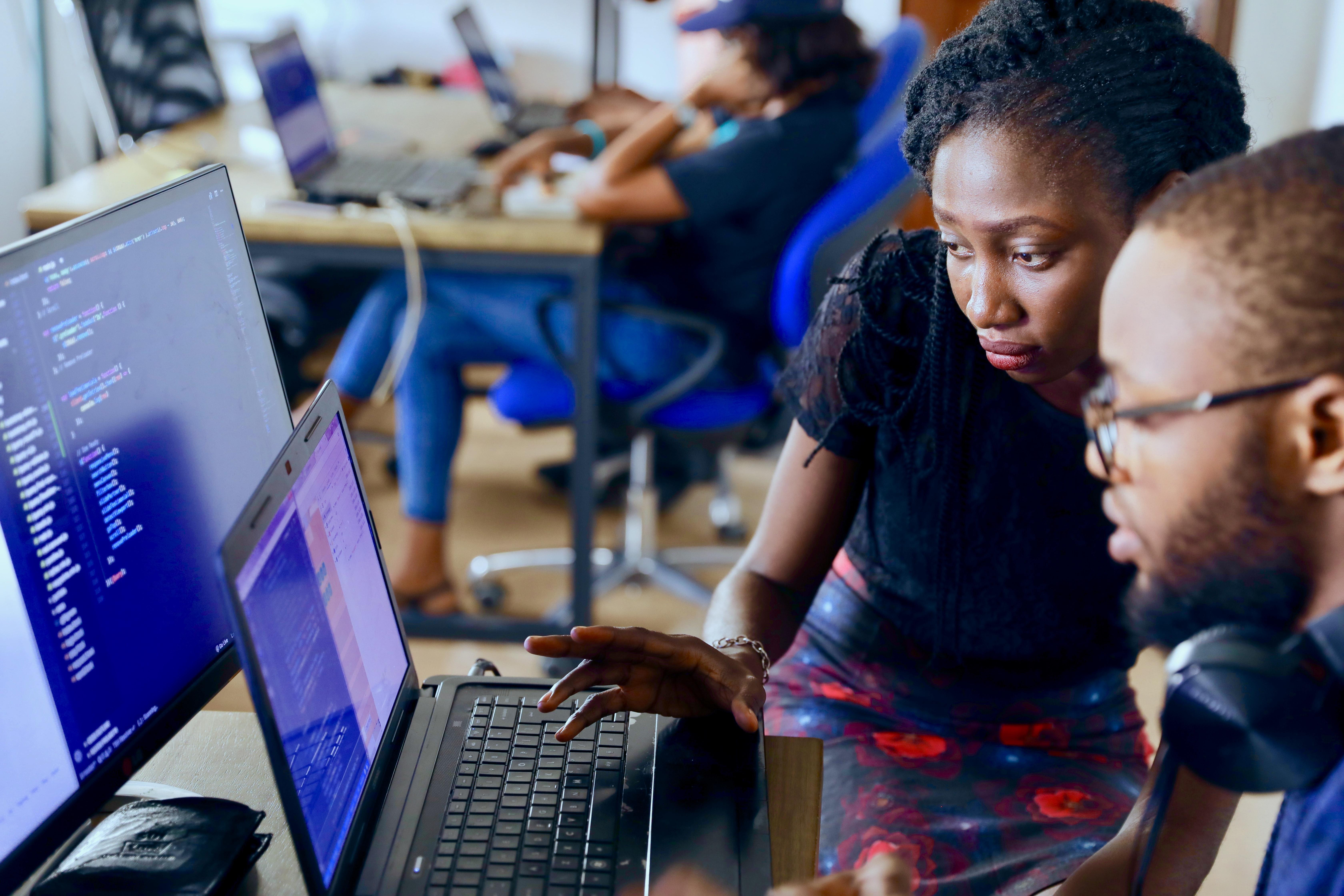 Developer explains to fellow developer in Visual Studio Code