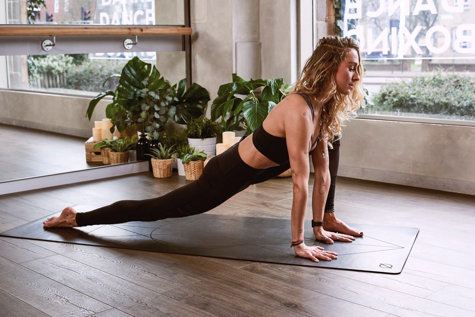 Girl doing yoga on a mat