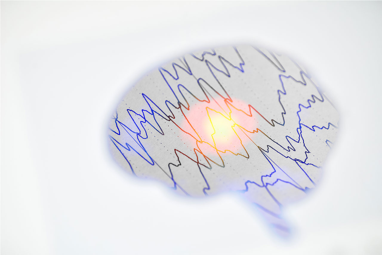 Image of a graphic depicting the brain with brainwaves inside of it