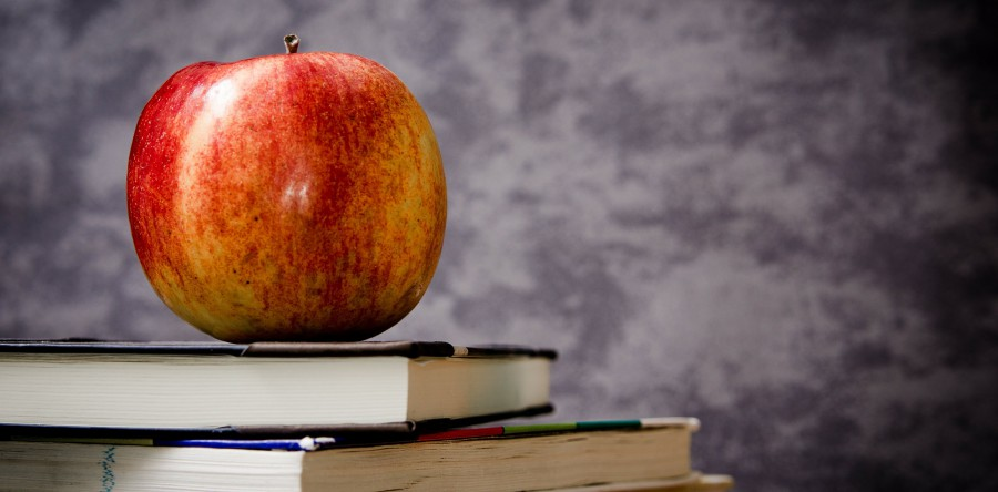 An apple on a stack of books