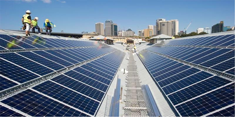 30kW solar system in Adelaide with 3 solar installers standing on roof