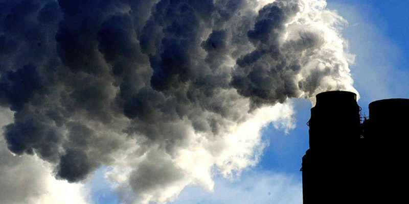 pollution pouring out of chimney into atmosphere