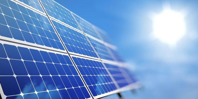 12 solar panels fading into bright sun