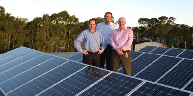 3 men from macquarie bank standing next to rooftop solar installation