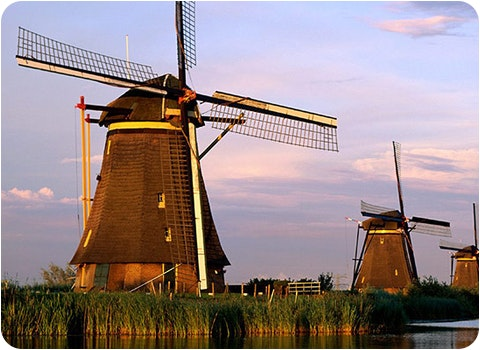 5 windmills on a river in the Netherlands
