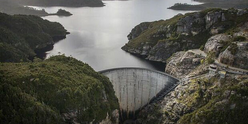 Tasmanian dam wall viewed from elevation on overcast day