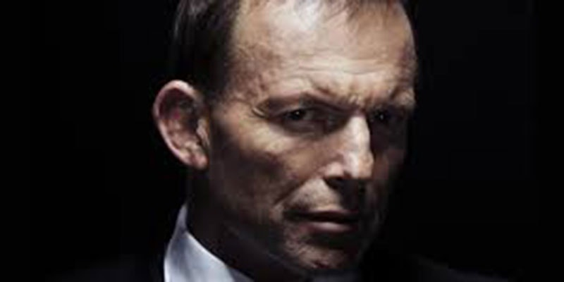 tony abbott's face looking ominous against black background