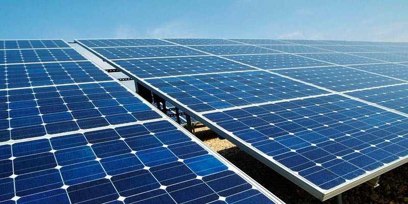 ground mounted solar panels with blue sky background