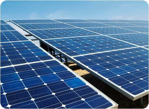 ground mount solar panels with blue sky background
