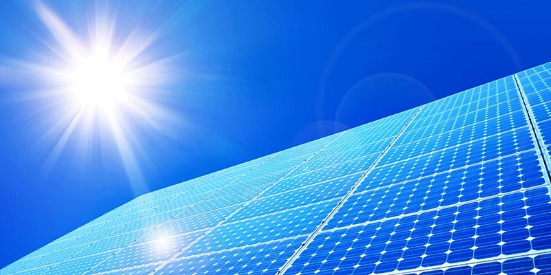twenty solar panels joined together with sunny sky background