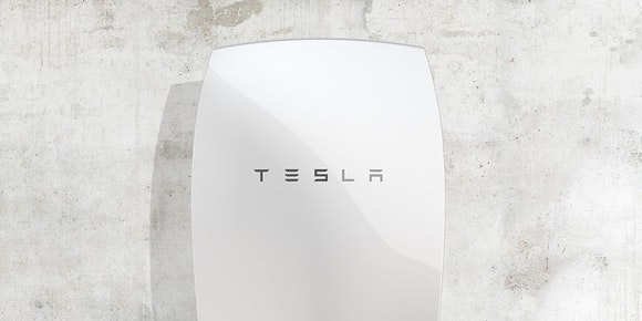 tesla powerwall battery mounted on concrete wall