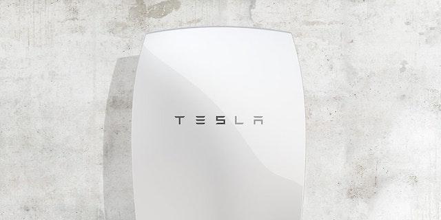 tesla powerwall battery mounted on concrete wall