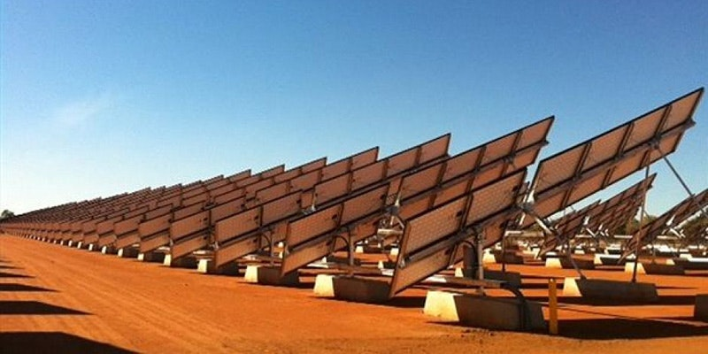 solar farm in Australian outback viewed from behind solar panels