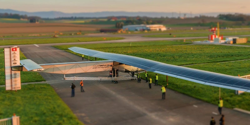 Solar Impulse 2 single-seater solar plane on runway getting checked by aviation officials