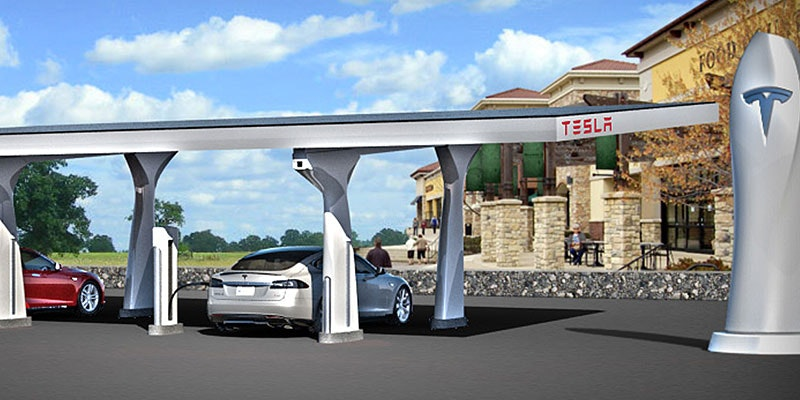 artist's rendition of tesla recharge station with 2 electric cars charging