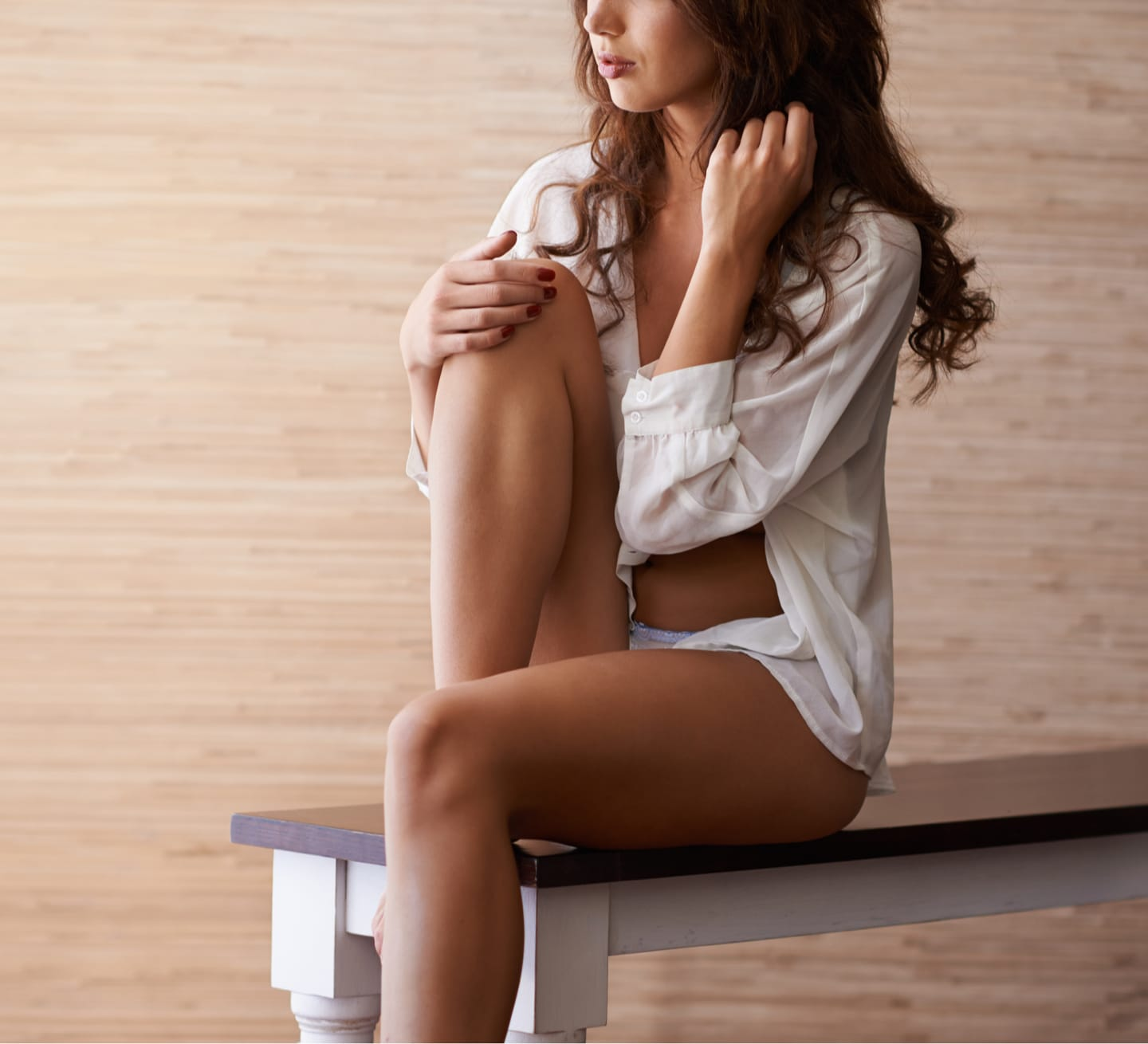 model on bench in a dress shirt