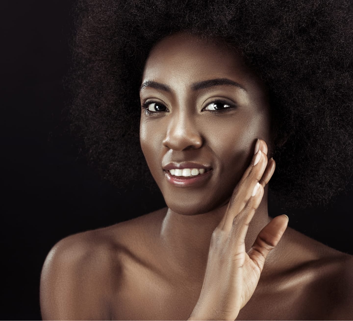 smiling model with face against hand