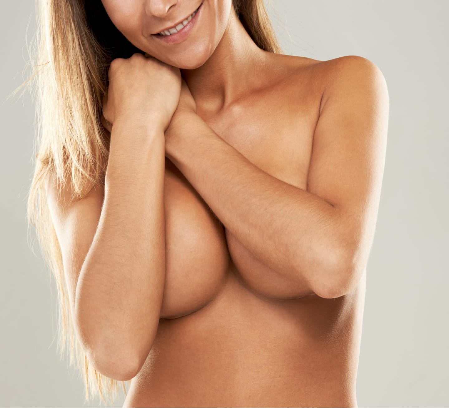 model holding breasts