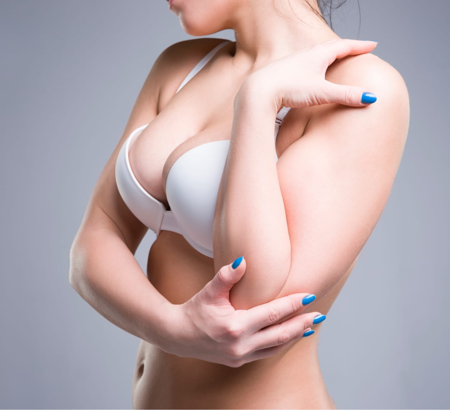 stock photo of woman in a white bra