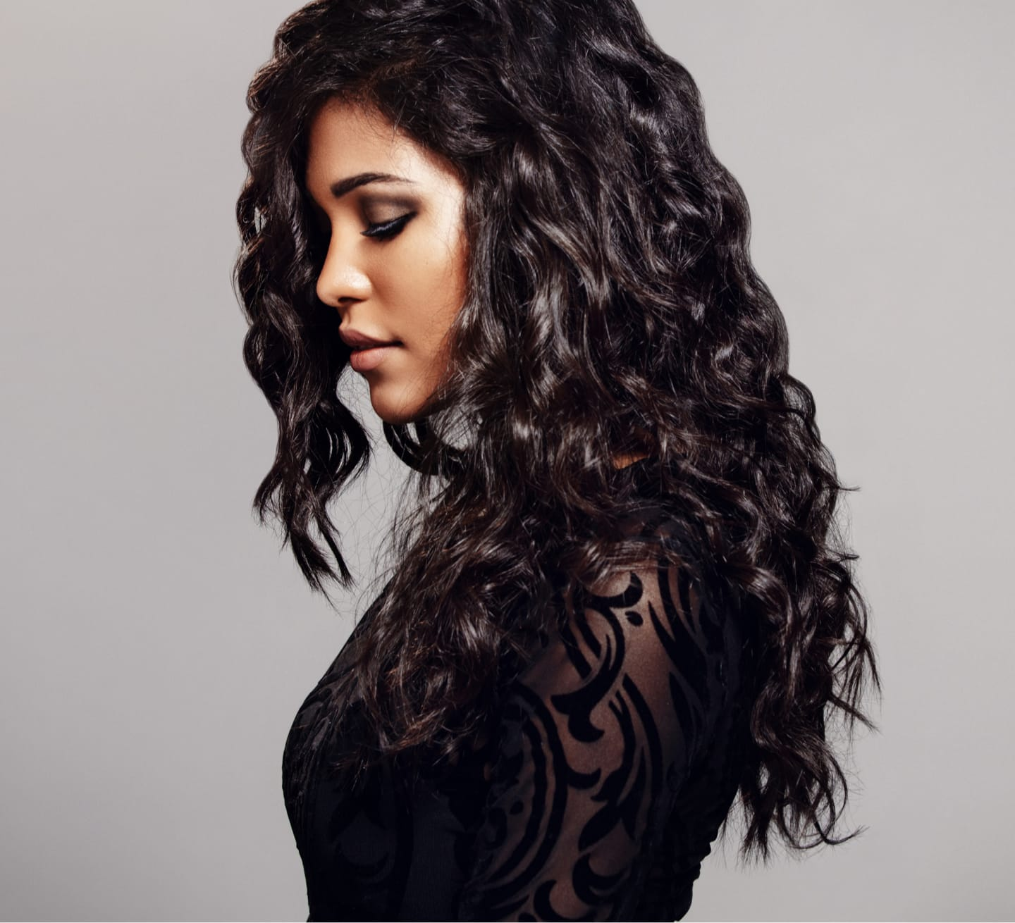 profile of model with wavy hair