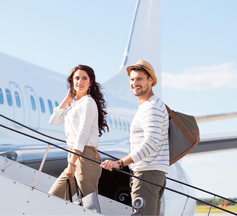 couple boarding plane