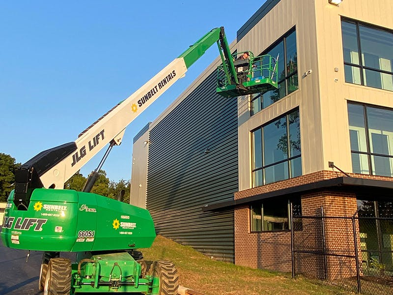 Clean Right Solutions LLC uses equipment to clean high rise building windows