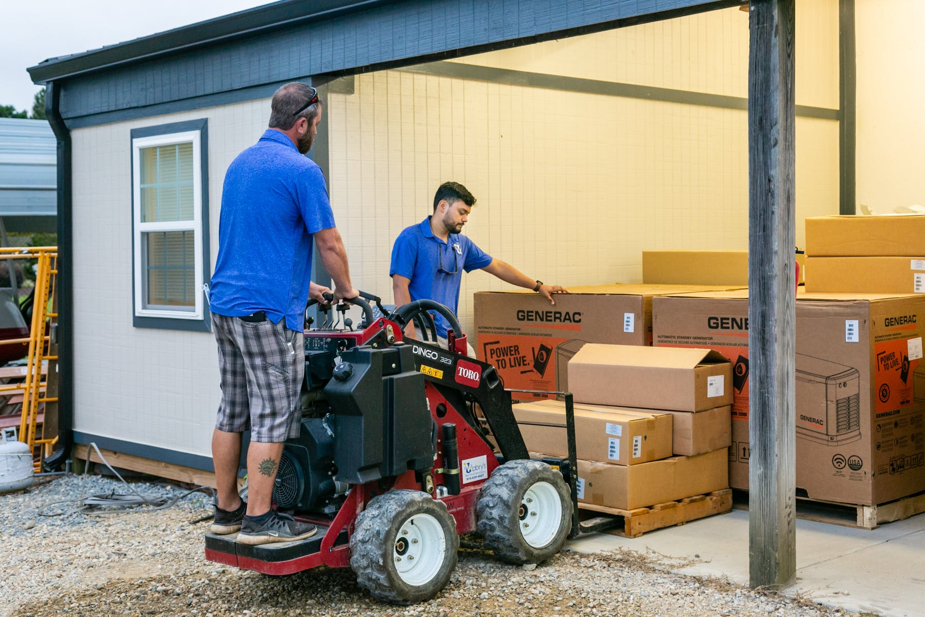 Mabry'c Electrical Inc employees moving boxes with small forklift