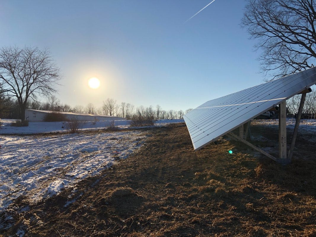 Appalachian Renewable Power Systems industrial solar panel installation with snow and sunrise!