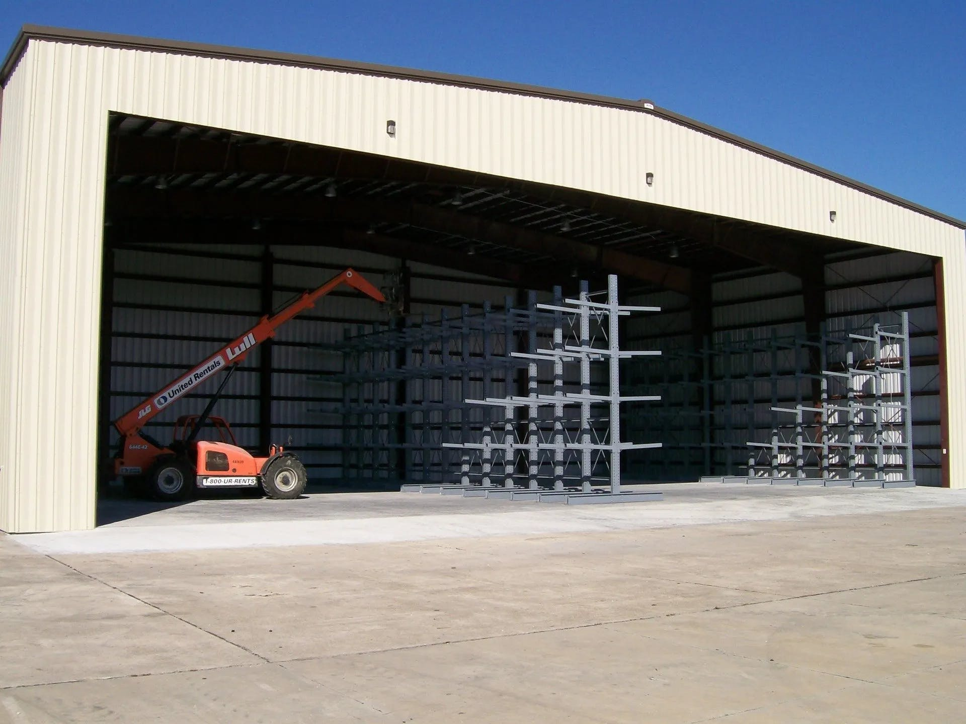 Stewart Group Enterprises with a crane in a warehouse