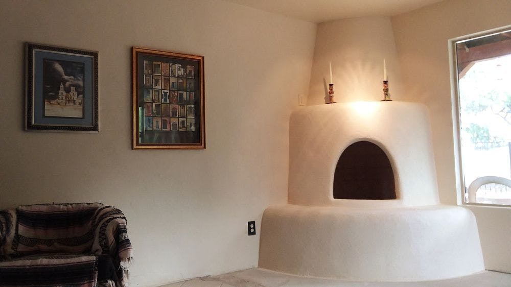 A brand new Kiva (beehive) fireplace built is the newest addition to the home.