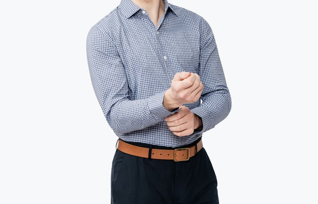 Men's Navy Grid Nylon Aero Dress Shirt on Model Facing Forward Adjusting Sleeve Cuffs