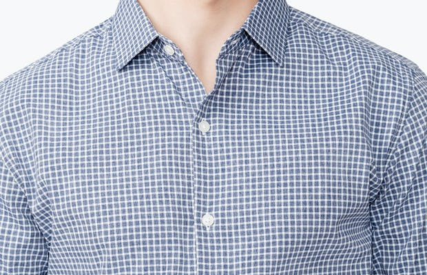 Men's Navy Grid Nylon Aero Dress Shirt on Model Facing Forward in Close-Up of Unbuttoned Collar